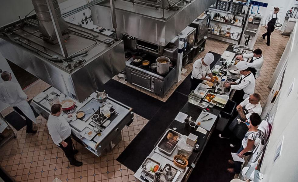 Overhead shot of chefs working in kitchen