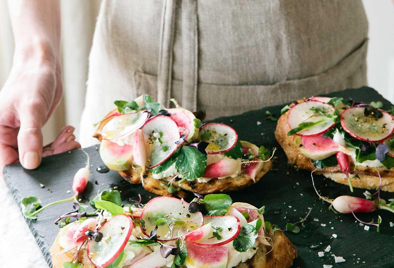 Tray of toast with radishes