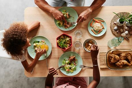 Overhead shot of people eating a table